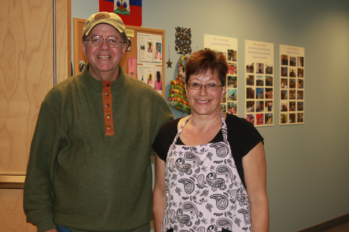 Church of God Pastor Laurence Wall poses with Julie Chase following Thursday's community dinner.