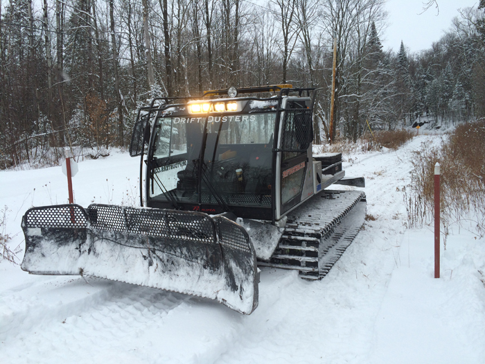 The groomer owned by the Drift Dusters Snowmobile Club based out of Derby, out on the trail packing snow on opening day.