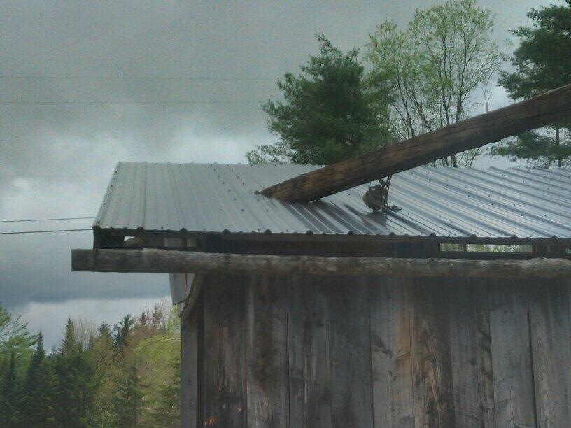 A pole was driven into the roof of a shed following a microburst early Saturday morning. Photo by meteorologist James Sinko of Lyndonville.