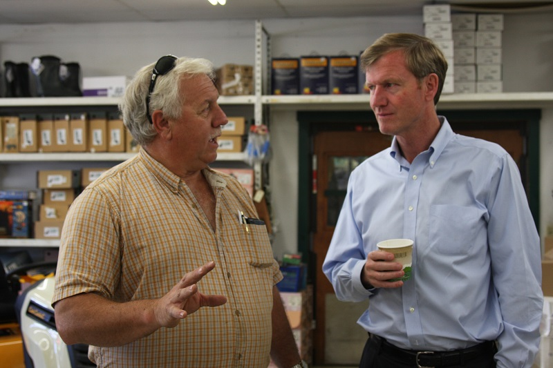 Scott Milne enjoying a conversation with Ron Wright on Tuesday morning at Newport Farm and Garden - Agway.
