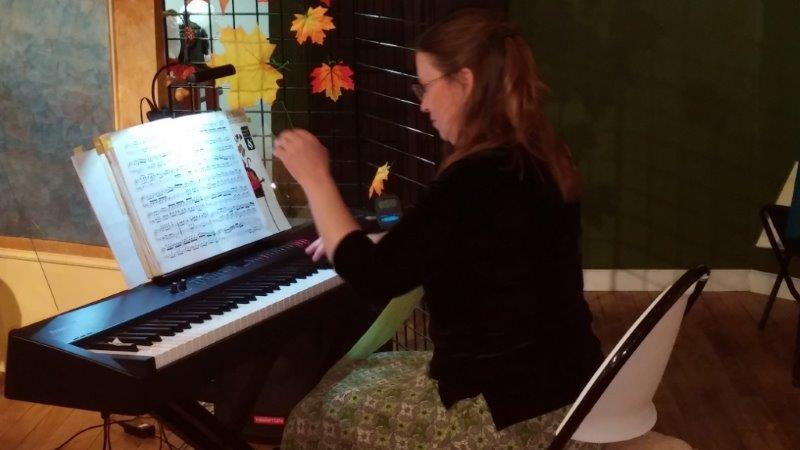 Janice Luce performs on piano.