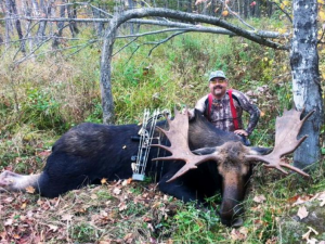 Kevin Rice, of Pomfret, with this record moose bull taken with a bow and arrow on Oct. 1, 2014.