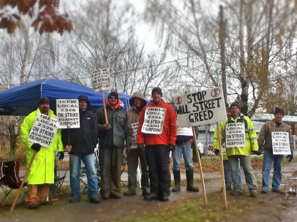 Local FairPoint workers form a picket line along Route 5 in Derby on Wednesday.