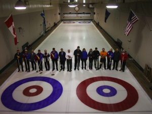 Players from the Tuesday night league at the Border Curling Club stop to take a group photo. All photos from this dispatch are by Tanya Mueller.