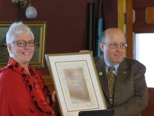 Mayor Paul Monette, pictured with Patricia Sears, receiving a plaque honoring Newport as an Age Friendly City.