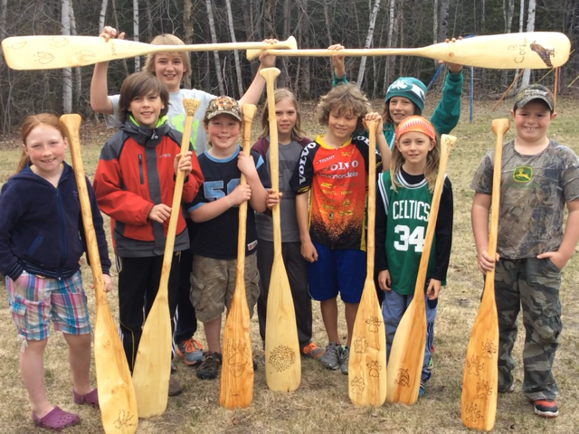Clyde River After School adventurers gather prior to a Green Up Day paddle on a Newport section of the Clyde. Paddles were 100% student made and wood donated for the paddles by Dean and Christie Aldrich was cut and milled from within the Clyde River watershed.