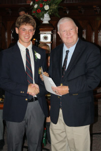 Ryan Fletcher receives the first Ashworth Scholarship from former teacher Peter Ashworth.