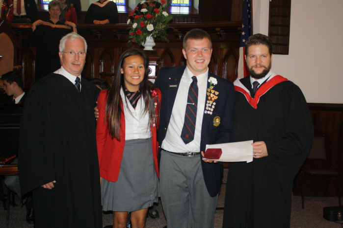 Jacob Hochstrasser-Borsari (middle right) shares the Pitcher Prize with Julia Gilpin, presented by College board chairman Jonathan Cowen (left) and guest speaker George Diamondoupolis, Class of 1994.