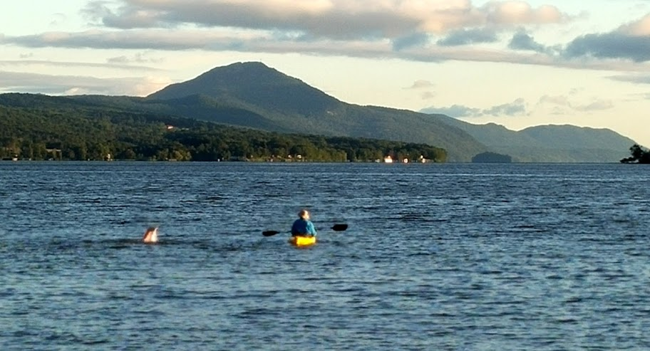 Lenning and kayaker Don Houghton Jr. of Craftsbury in Derby Bay heading north.