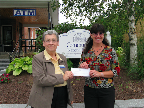 Madeleine Roy of GMUW, left, and Sheila Gleason of Community National Bank.
