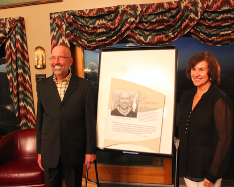 Dr. Bob and Mrs. Carol Trembley pose by the newest Legend plate in his honor, that will hang on the Legends display in the lobby of North Country Hospital.