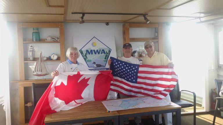 Flag exchange celebrates two active watershedstewards of Lake Memphremagog