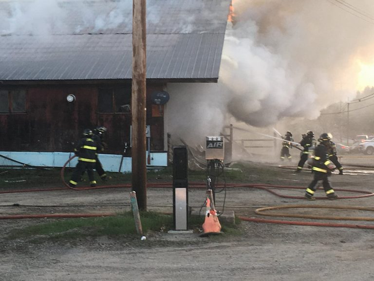 Scenes from fire at Missisquoi Lanes in Lowell