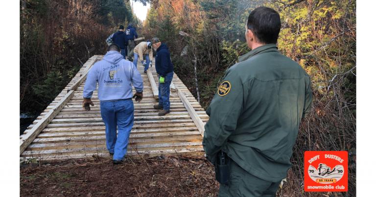 Local snowmobile club helps Border Patrol repair bridge in Holland