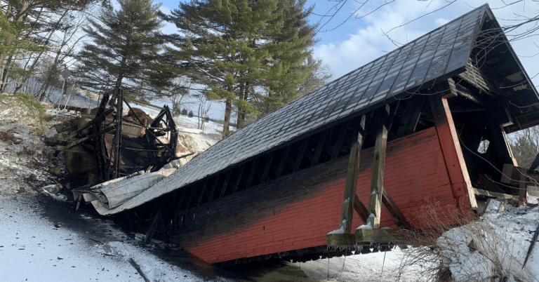 Snowmobile fire destroys 111-year-old covered bridge in Troy